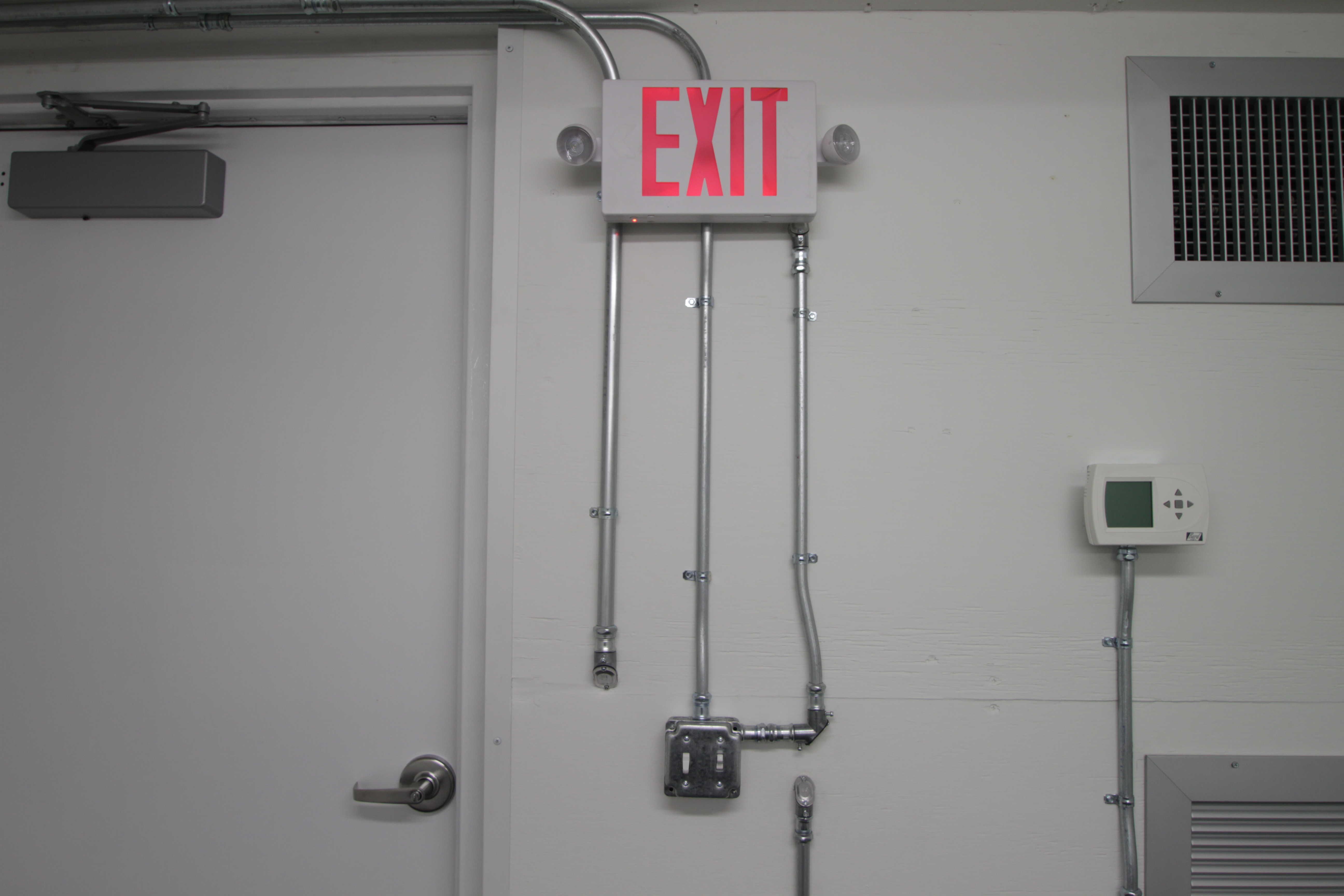 Blast resistant module exit sign