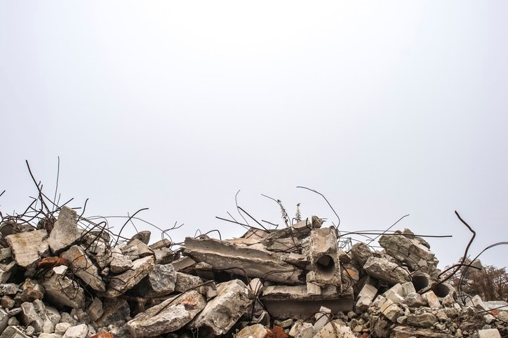 A pile of rubble as a result of a natural disaster.